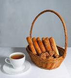 Basket with bread and sweet and tea Stock Images