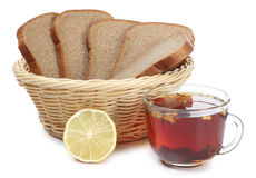 Basket bread and tea Stock Images
