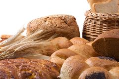 Basket and bread on white Royalty Free Stock Photography