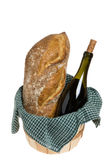 Basket with bread and wine Stock Images