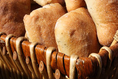 Basket of bread. Woven basket filled with fresh rolls of bread ready for sale at a farmer's market Royalty Free Stock Image