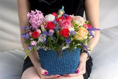 Basket with bright flowers at girl hand Royalty Free Stock Images