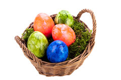 Basket of brightly coloured Easter Eggs Royalty Free Stock Photos