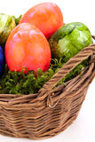 Basket of brightly coloured Easter Eggs Stock Photo