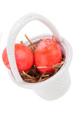 Basket of brightly coloured Easter Eggs Stock Image