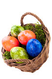 Basket of brightly coloured Easter Eggs Royalty Free Stock Photography