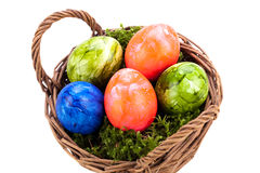 Basket of brightly coloured Easter Eggs Stock Photography