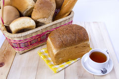 Basket with brown bread and tea Royalty Free Stock Image