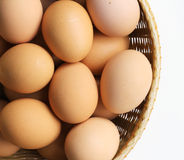 Basket of Brown Hen's Eggs. Overhead view of a wicker basket filled with brown hen's eggs Stock Images