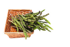 Basket with bunch of asparagus isolated selective focus on head Stock Photography