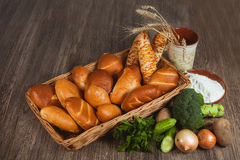 Basket with buns and bread Royalty Free Stock Photography