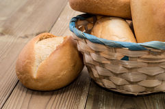 Basket with buns on wooden background Stock Photos