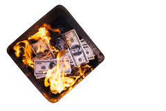 Basket with burning dollars Stock Images