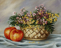 Basket with buttercups and apples Stock Photography