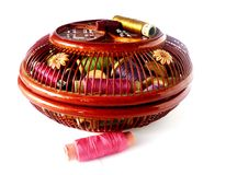 Basket with threads. Wooden basket with colour threads Stock Photo