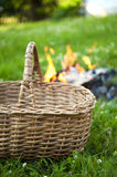 Basket and camp fire Royalty Free Stock Images