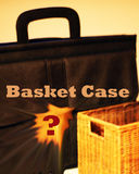 Basket Case. A case and basket together forming the concept basket case. A modern term for someone stressed or loosing they're mind Royalty Free Stock Image