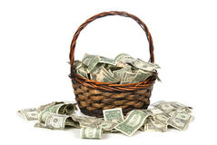Basket of cash. A wicker basket with handle holds a pile of cash.  Good for most financial inferences including investment, retirement, savings, wealth and the Stock Images