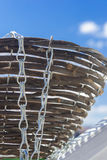 basket on a chain under the bright sky Royalty Free Stock Photography