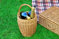 Basket With Champagne Wine, Picnic Hamper And Blanket Stock Photo