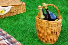 Basket With Champagne Wine, Picnic Hamper And Blanket Stock Photography