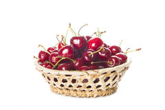 Basket with cherries isolated on a white background Stock Images