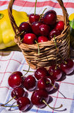 Basket with cherries Stock Photos