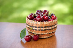 Basket of Cherries on Table Royalty Free Stock Image