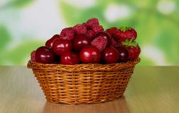Basket with cherry and strawberry berries Royalty Free Stock Image