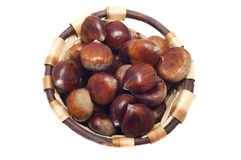 Basket of chestnuts, autumn fruits, isolated. On white Royalty Free Stock Photography