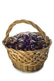 Basket with chestnuts isolated on a white background Royalty Free Stock Images