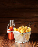 Basket of chips or French fries with red sauce Stock Photography