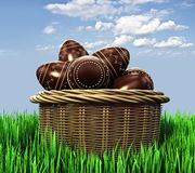 Basket with chocolate candy Easter eggs Royalty Free Stock Photos