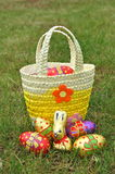 Basket of chocolate easter eggs. A basket of chocolate easter eggs in a garden Royalty Free Stock Photo