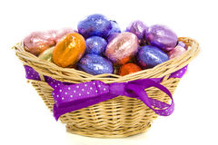 Basket with chocolate eggs Royalty Free Stock Photography