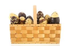 Basket chocolate eggs Royalty Free Stock Photos