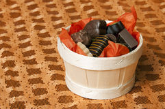 Basket of chocolate on orange background Stock Image