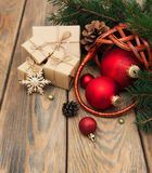 Basket with christmas baubles Stock Images