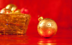 Basket with christmas baubles on red Royalty Free Stock Photography