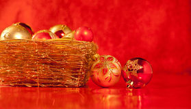 Basket with christmas baubles on red Stock Photo