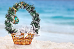 Basket with Christmas decorations on a beach at the region of the sea Stock Photo