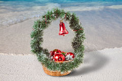 Basket with Christmas decorations on a beach at the region of the sea Stock Image