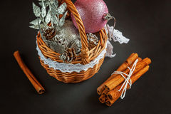 Basket with Christmas decorations on black background Stock Photography