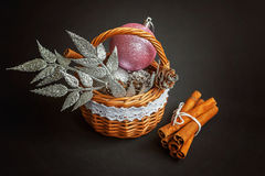 Basket with Christmas decorations on black background Stock Photo
