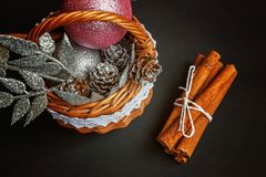 Basket with Christmas decorations on black background Royalty Free Stock Photos