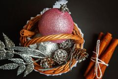 Basket with Christmas decorations on black background Stock Image