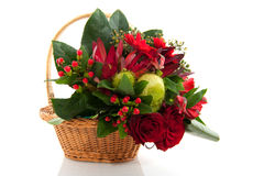 Basket with christmas flowers Royalty Free Stock Photography