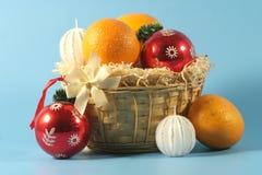 Basket with christmas fruit. Stock Photo