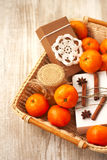 Basket with Christmas gifts: honey, tangerine and a box with sou Stock Photography