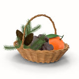 Basket with Christmas gifts on white background. In a wicker basket are candy, tangerines, branches of the spruce is a gift for Christmas. Presented on a white Stock Image